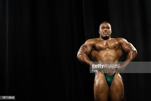 posing bodybuilder - black male bodybuilders stock photos and pictures