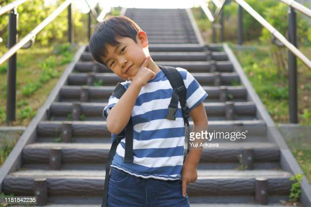 a posing boy - 少年 ストックフォトと画像