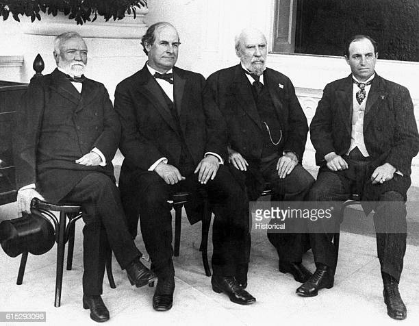 Posing for a photograph at the White House in the early 20th century are Andrew Carnegie head of US Steel Company William Jennings Bryan noted...