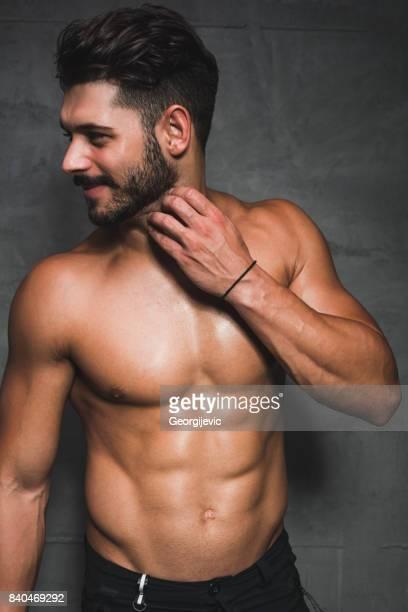 Posing shirtless in the studio