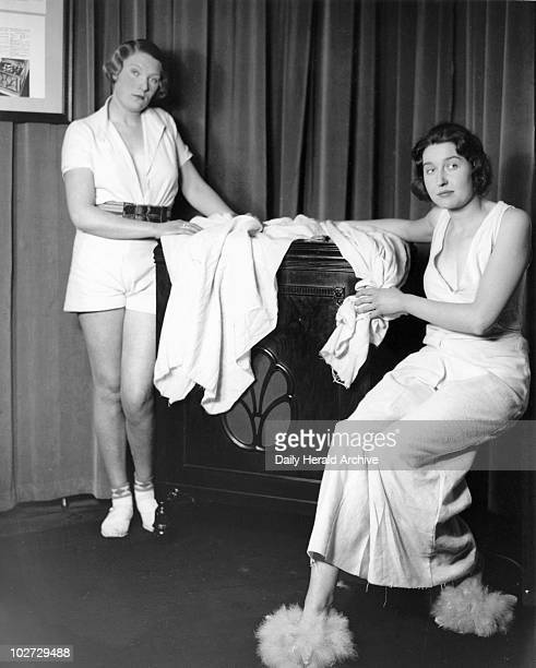 Posing with the latest HMV gramophone 31 January 1933 The women are wearing clothes made from new packing cloth Photograph by Woodbine taken at the...