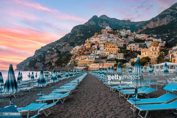 positano at sunset, amalfi coast, italy - italy stock pictures, royalty-free photos & images