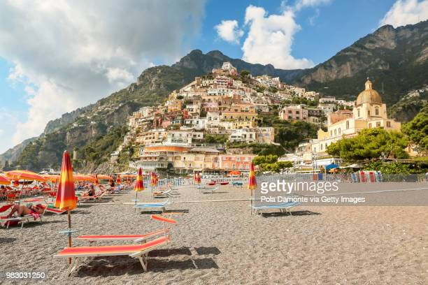 positano village and the blue mediterranean sea - sorrento italy stock pictures, royalty-free photos & images