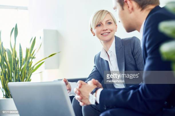 positive business consultant working with client - financial advisor stock pictures, royalty-free photos & images