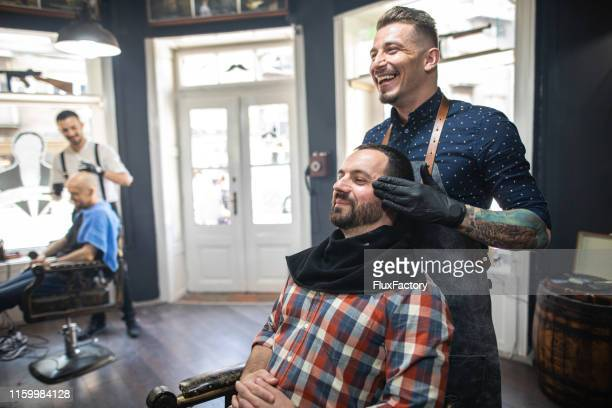 positive energy flowing through a barber shop - barber stock pictures, royalty-free photos & images