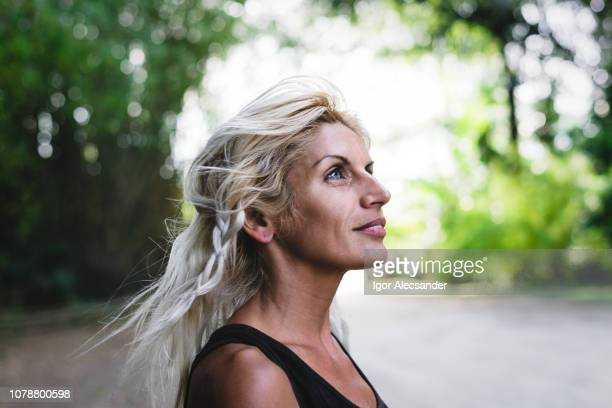 positive fitness woman at public park - hope stock pictures, royalty-free photos & images
