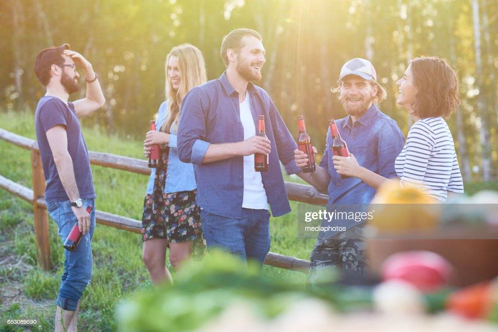 Positive friends with beer : Stock Photo