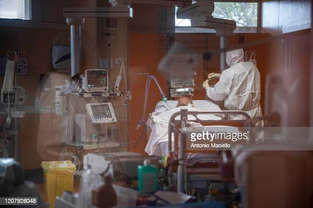A COVID19 positive patient is treated by doctors in the third Covid 3 Hospital during the Coronavirus emergency on March 21 in Rome Italy Hospitals...