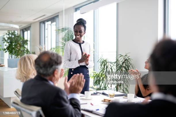 positive reception to corporate board room presentation - gratitude stock pictures, royalty-free photos & images