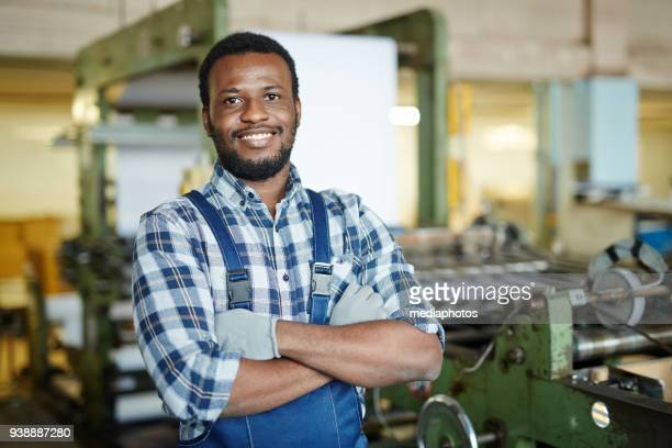 Positive repairman examining printing machine