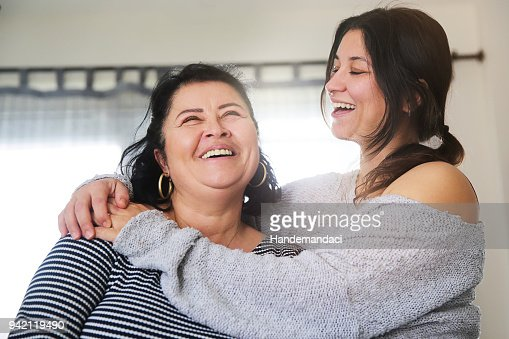 Positive senior mother and her daughter embracing