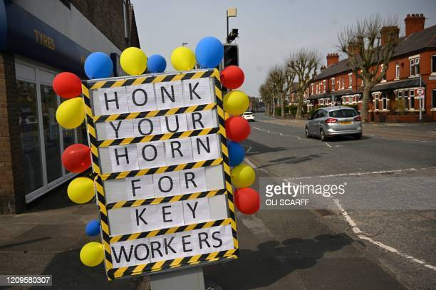 A positive sign heralding the NHS workers battling the novel oronavirus COVID19 is seen on a neardeserted street in Warrington North West England on...