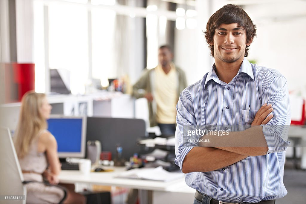 Positivity and confidence make him a great team player! : Stock Photo