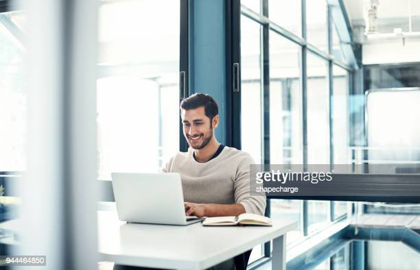 positivity predicts productivity - man in office stock photos and pictures