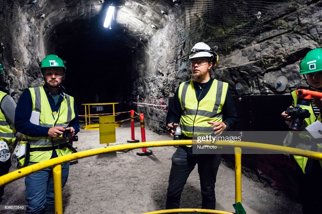 Posiva geologist Tuomas Pere (white helmet) and media representatives in a demonstration tunnel approximately 420 meters underground at Posiva's spent nuclear fuel repository ONKALO in Olkiluoto, Eurajoki, Finland on 17 August 2017.