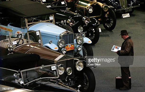 Possible buyer views motor cars for sale at the Bonham's Car Auction on December 3, 2007 in London. The Important Collectors' Motor Car sale is one...