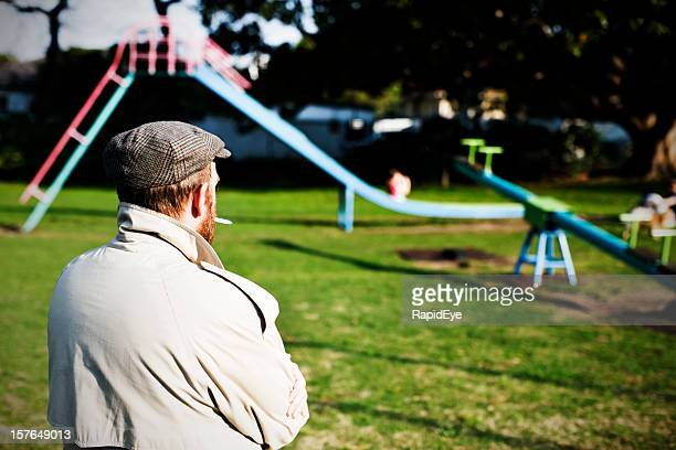 possible pedophile watches a children's playground for potential prey - streaker stock pictures, royalty-free photos & images