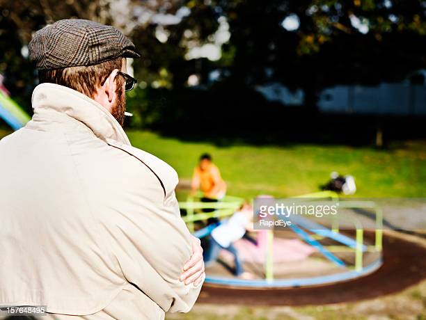possible pedophile watches kids play in park - streaker stock pictures, royalty-free photos & images