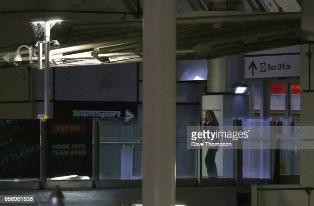 A possible Police Investigator exits the Box Office entrance to the Manchester Arena on May 23 2017 in Manchester England An explosion occurred at...