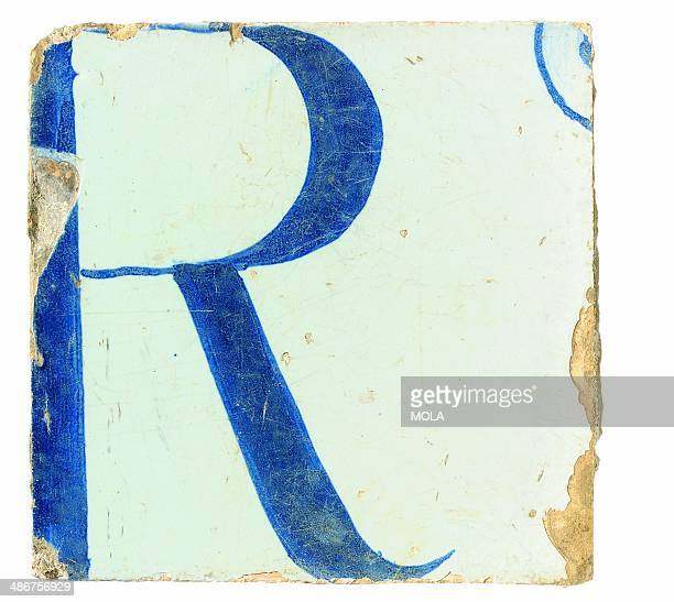 Possibly English painted tile possibly part of a trade sign showing the letter R mid 18th century from the 19922001 excavations at the Merrill Lynch...