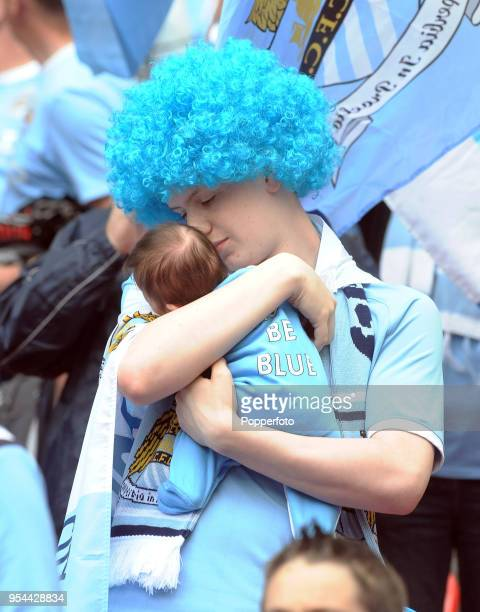 Possibly the youngest Manchester City fan in the crowd onemonthold Emilia Hughes with her Uncle Joel during the FA Cup sponsored by EON Final match...