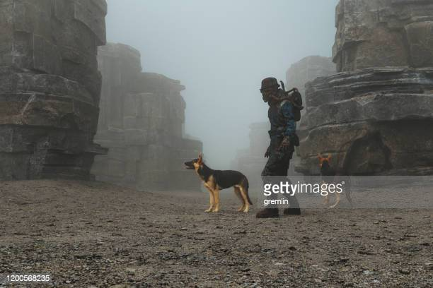 post apocalypse steampunk character with dogs - rock formation stock pictures, royalty-free photos & images