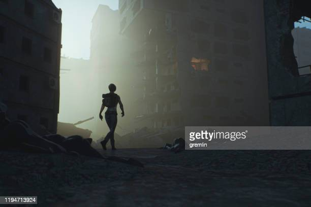 post apocalypse survivor walking in destroyed city - rubble stock pictures, royalty-free photos & images