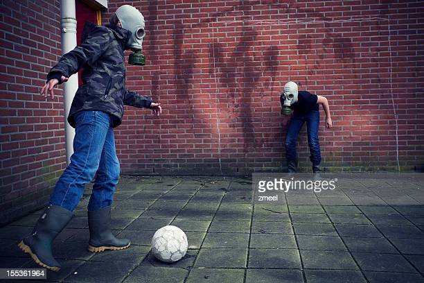 Post Apocalyptic boys playing soccer