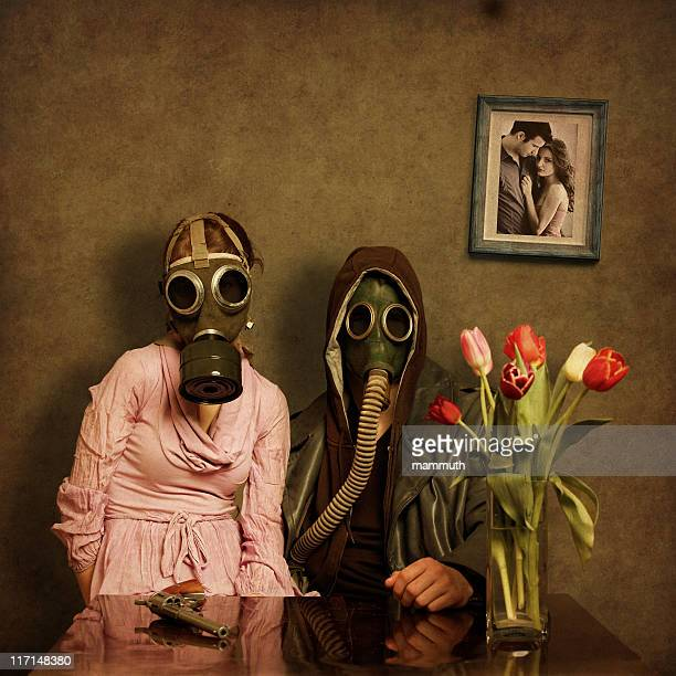 post apocalyptic couple - gas mask stock pictures, royalty-free photos & images