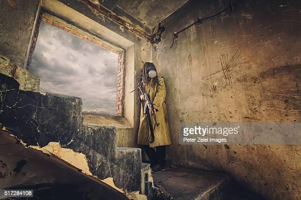 Post apocalyptic survivor in a ruined building