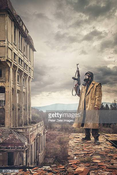 Post apocalyptic survivor on the roof of a ruined building