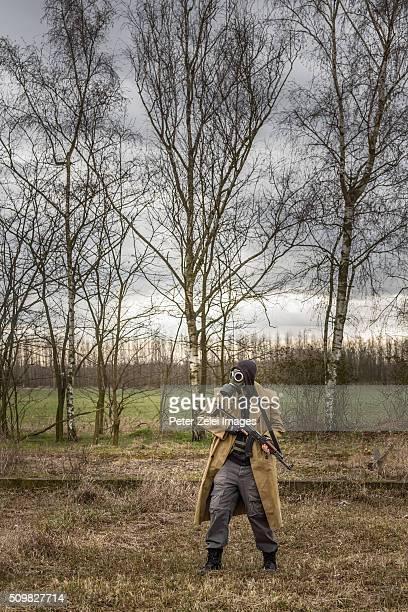 Post apocalyptic survivor or stalker exploring outdoors