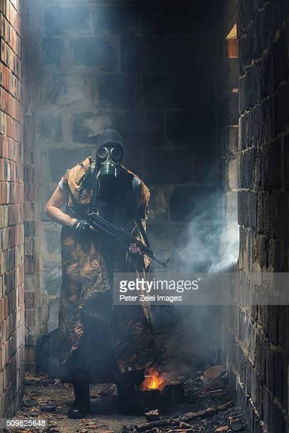 Post apocalyptic survivor or stalker in a damaged building