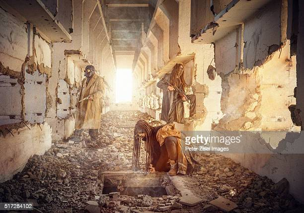 post apocalyptic survivors exploring a ruined building - doom patrol stock-fotos und bilder