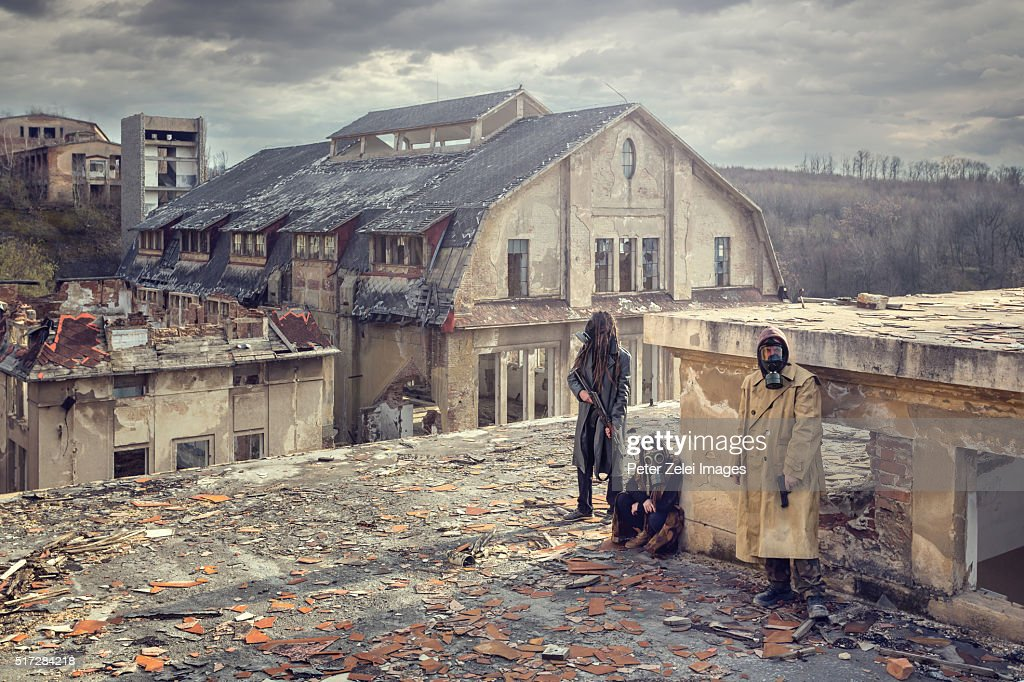 Post apocalyptic survivors on the roof of a ruined building : Stock Photo