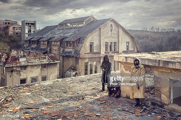 Post apocalyptic survivors on the roof of a ruined building