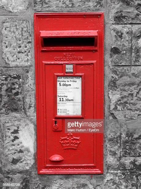 post box on stone wall - hutton stock photos and pictures