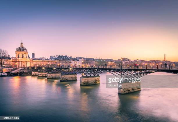 Post des Arts bridge over the Seine River at spring sunset in Paris, France.