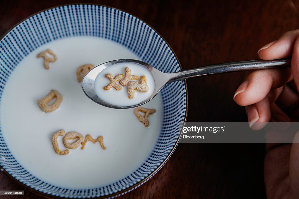 Post Foods LLC Alpha-Bits cereal letters spell out 'XYZ' on a spoon and 'COM' in a bowl in this arranged photograph taken in New York U.S., on Wednesday, Aug. 12, 2015. Google Inc. rose as much as 6.5 percent after reorganizing into a holding company called Alphabet Inc., breaking out its main Web operations from ambitious new endeavors such as research lab Google X and Calico, which seeks to extend human lives. The structure, announced Monday, will give greater clarity into how Google invests in various ventures, including driverless cars, high-speed Internet service and health-related technologies. Photographer: Chris Goodney/Bloomberg via Getty Images