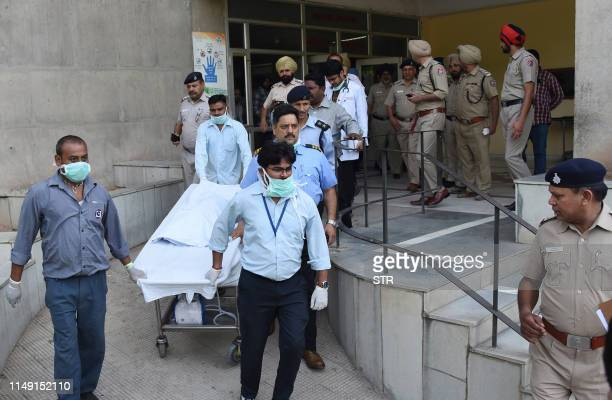 Post Graduate Institute of Medical Education and Research personnel move on a stretcher transporting the body of twoyearold boy Fatehveer Singh who...