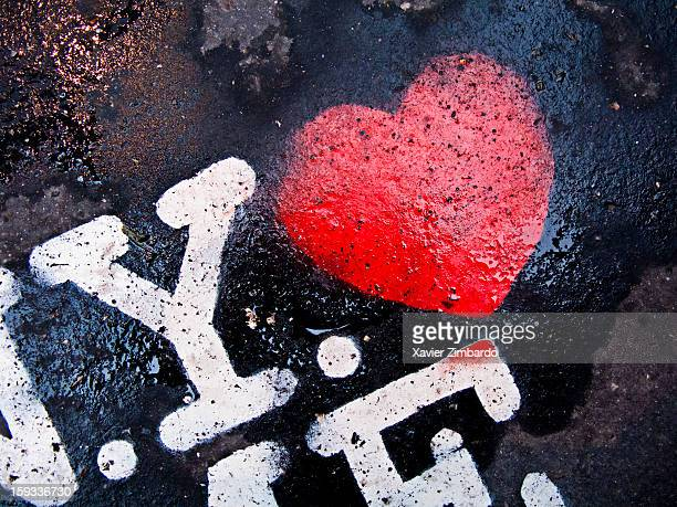 Post Graffiti of NYC and a red heart stencilled on street on January 6 2010 in Paris France