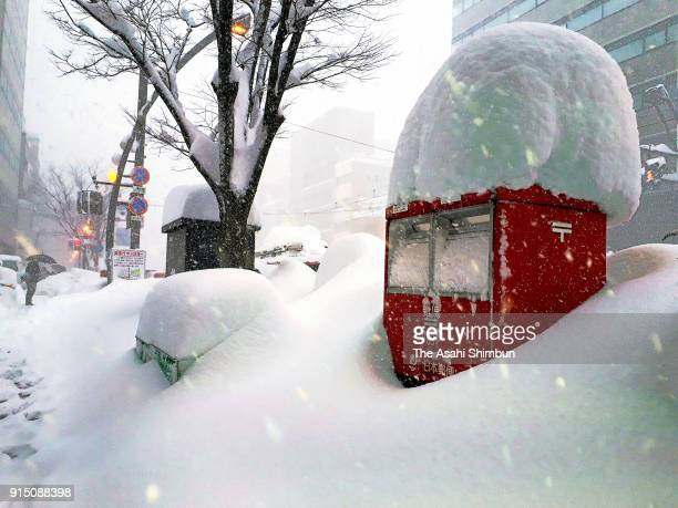 A post is covered with snow on February 6 2018 in Fukui Japan The SelfDefense Forces were called out to rescue around 1000 vehicles stranded in heavy...