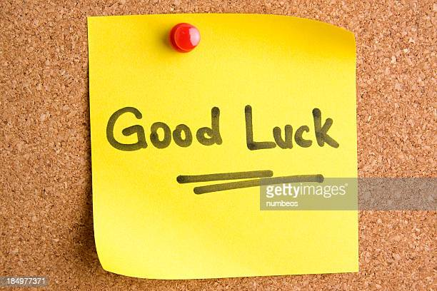 a post it note saying good luck with a red pin - luck stock photos and pictures