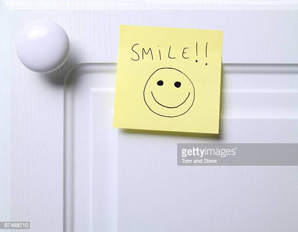 post it note - smile!!   - smiley face stock pictures, royalty-free photos & images