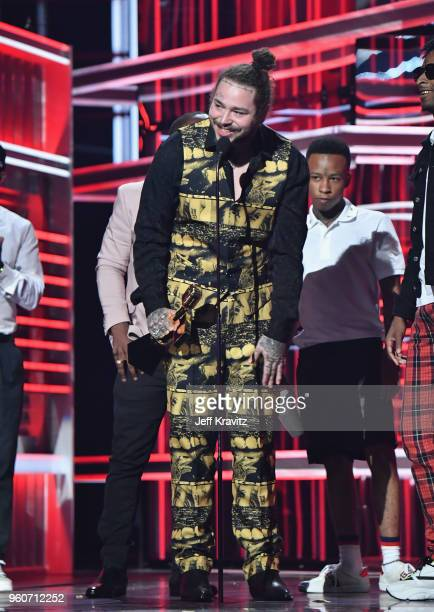 Post Malone accepts an award ofr his song ft 21 Savage 'Rockstar' onstage during the 2018 Billboard Music Awards at MGM Grand Garden Arena on May 20...