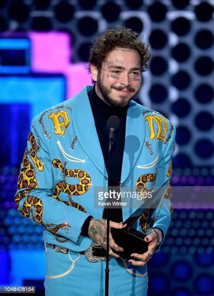 Post Malone accepts Favorite Male Artist Pop/Rock onstage during the 2018 American Music Awards at Microsoft Theater on October 9 2018 in Los Angeles...