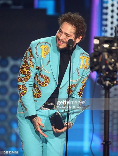 Post Malone accepts the Favorite Male Artist Pop/Rock award onstage during the 2018 American Music Awards at Microsoft Theater on October 9 2018 in...