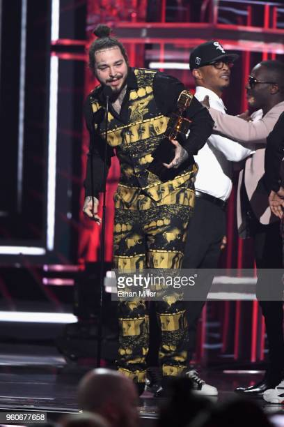 Post Malone and 21 Savage accept an award onstage during the 2018 Billboard Music Awards at MGM Grand Garden Arena on May 20 2018 in Las Vegas Nevada