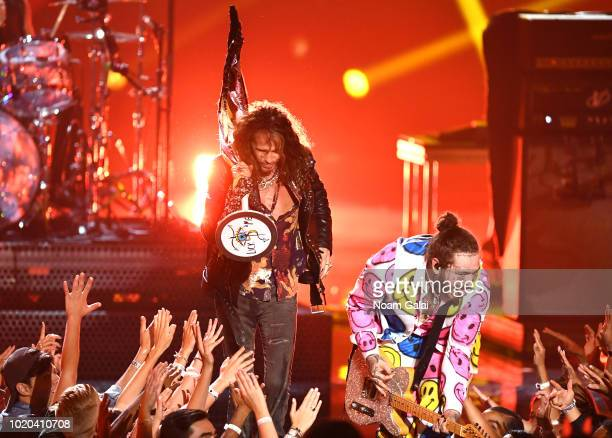 Post Malone and Aerosmith perform onstage during the 2018 MTV Video Music Awards at Radio City Music Hall on August 20, 2018 in New York City.