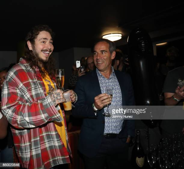 Post Malone and Monte Lipman Attend Post Malone In Concert at PlayStation Theater on September 19 2017 in New York City